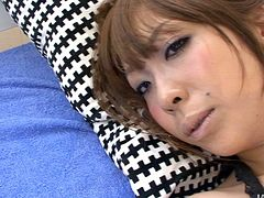 Arousing Japanese bimbos in steamy black camisole and blue lingerie and stockings gets her mouth plugged with gag as she lies bandaged on her back getting her asshole and pussy fingered.