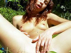 Arousing babe with small tits likes stroking her vag in outdoor solo masturbation