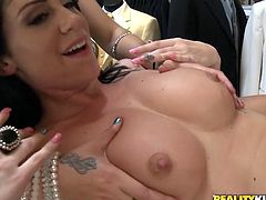 Superb brunette chicks show their hot tits and suck a cock in a shop. After that they get their shaved pussies fucked hard.