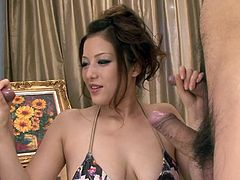 Meisa is a very pretty Nippon lady but she's a lustful whore and now she needs some cum on those sweet tits. She's down on her knees surrounded by horny men that want to cum on her. She begins to suck and rub their cocks and maybe if she keeps up the good work they will cum all over her hot breasts