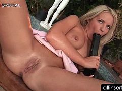 Dirty blonde nymph sucking and teasing snatch with giant dildo