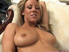 This spectacular MILF in lingerie is Carolyn Reese and she's giving the most amazing blowjob in this POV scene.