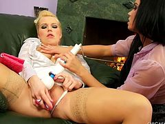 Mind taking brunette babe bends down to get her cunt pounded with a dildo, which is held by the mouth of insatiable blond domina in peppering sex video by Tainster.