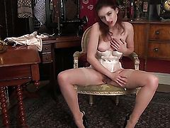 Fawna Latrisch is completely naked and plays with her bush non-stop