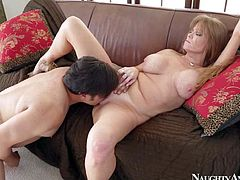 Gorgeous and hot busty milf Darla Crane enjoys in pleasing her man Anthony Rosano after hes came home from work and gives him a hot titjob on her knees