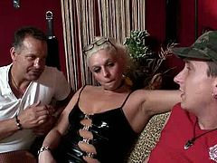 Well, if you wanna have a trip to the Red Light District this clip is surely a great guide. Two dudes come to the brothel, interviews kinky slim blond whore in black stuff and heels. Ugly bitch with nice boobs and not bad ass is ready to please her clients if she's paid well.