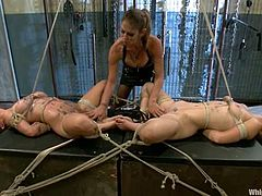 Bryn Blayne and Felony get gagged and tied up by their sexy Mistress. Then these babes get their asses and pussies toyed deep.