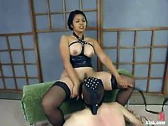 See the torture, domination, humiliation this guy gets from Mika Tan who is having such a great time she can't hide it!
