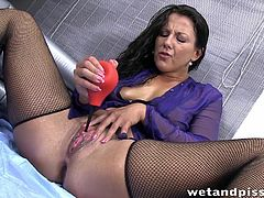 Piss soaked Valentina Ross is feeling filthy and turns up in fishnet stockings and a sheer purple blouse. Immediately she grabs a wine glass and fills it with her warm pee