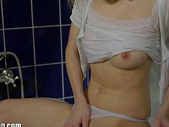 Gorgeous young Angel Piaff takes a bath with her white top and panties on. After she takes them off, she masturbates.