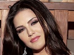 Steel fishnet dress of fabulous busty brunette Sunny Leone is hot looking. She takes it off and wants to masturbate on cam!