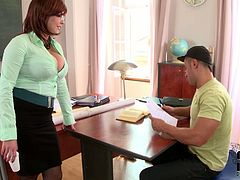 Charming brunette teacher with big melons gives her student a titjob