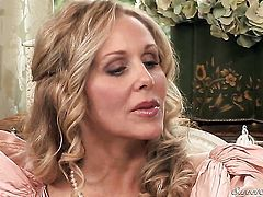 Julia Ann blows Xander Corvuss cock with passion