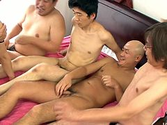 Sextractive Japanese hussy in sultry lingerie pleases four horny daddies in sultry gangbang sex video by Jav HD. She rides one of them in reverse cowgirl style while giving triple blowjob.