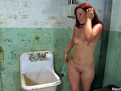 Kinky redhead girl strips her clothes off in some old building. After that she toys both her holes with great pleasure.