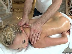 She is relaxing on the bed and the guy is pleasing him with a massage. After oiling her hot body this guy spreads her sexy legs and rubs that shaved pink cunt of hers before putting his hard dick in her mouth. It seems like this horny bitch is enjoying every inch of that huge man meat. Watch!