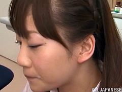 Kinky Japanese girl in school uniform gives pleasure to some lucky guy. She stands on her knees in front of him and blows his cock.