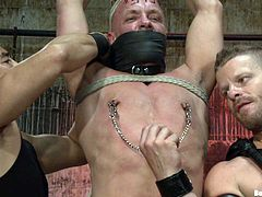 Get a load of this gay bondage video where these guys have fun penetrating one another's assholes after torturing one another.