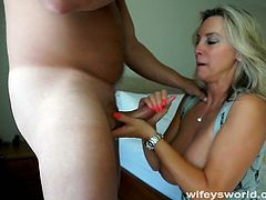 Blonde MILF with huge tits jerks off her husband before he fucks her enormous rack and shoots his entire load into her mouth and she swallows it down.