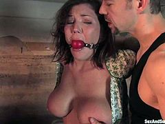 Well-endowed brunette Claire Dames lets horny stud Erik Everhard tie her up and fuck her nice holes deep and hard. Then Eric attaches pegs to Claire's body and they both enjoy it much.