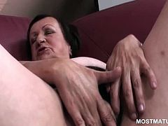 Lonely naked mature touching her hungry cunt in close-up