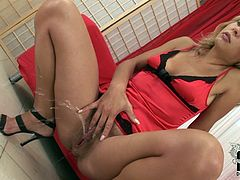 Blond chick wears sexy red peignoir specially for you because her only intention filming in solo action is to make you have a hard boner. She squats down with her knees spread wide showing off her bushy pussy. She rubs her snatch rolling eyes with pleasure.