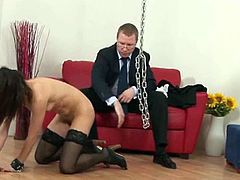 This submissive chick gets her normal punishment with a paddle, chains and a whip. He gives her permission to rub her pussy.