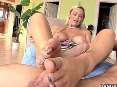 Abbey Brooks gets her soles licked by her boyfriend. He touches her boobs and she wraps her feet around his throbbing hard cock. Her toes are painted nicely and she uses her mouth and hands as well as her feet. She turns around so he can look at her ass while she jerks him off with her feet.
