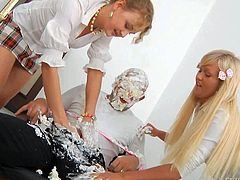 Omar Galanti gets his hard rod covered with whipped cream and then licked and sucked by two nasty blonde hotties, Anita Hengher and Bella D on their knees