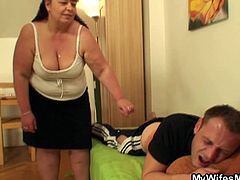 Check out this dude getting his back massaged by his wife's mom then receiving a nice blowjob and fucking her fat cunt!