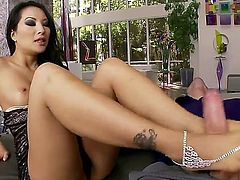 Stunning asian porn queen Asa Akira with dark heavy make up and perfect jaw dropping body in black dress gives awesome foot job to her horny lover with long shaft.