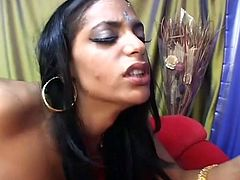 She is an exotic woman with small tits and a nice round ass. She bends over to let her horny lover fuck her in doggy position and then she sucks his stiff dick like a seasoned pro.
