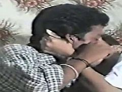 Looks like amateur Indian couple having date. They drink some alcohol and then start kissing while stroking each other in their bed.