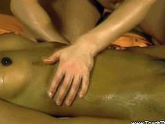 Young ebony enjoys a nice lesbian massage. Her hot body is oiled up and her friend is massaging her pussy and tits in a tantric way!
