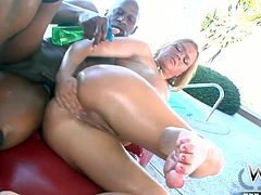 Busty blonde Krissy Lynn shows her horny black lover how she likes to treat a man. She pleases him with an amazing blowjob and then she spreads her legs wide to let him get a taste of her pussy. After a while he fucks her in missionary position.