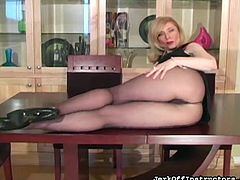 Stunning blonde milf with big tits likes posing her sexy pantyhose in naughty solo