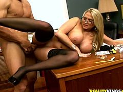 Amazingly hot blonde office babe gives an amazing blowjob & titjob combo. Later on she takes big dick in her tight pussy.