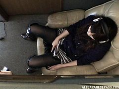 Amazingly beautiful Japanese babe is listening to music for relaxation. As she is alone she thought, that there is not harm in making her pussy wet. She doesn't know that the camera is there. She spreads her legs right on the chair and starts rubbing her pussy, underneath her panties and moans.