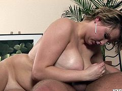 Chunky milf Ruby has huge tits and they glow when greased up nicely. That man drills her in the cunt hard in bed and fucks her tits as well.
