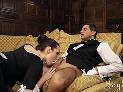 Instead of doing their jobs french maid Paige and butler Demetri are acting very naughty. He takes a sit on the couch and the maid begins taking care of his cock. First she rubs his dick and then gives it a short, mean suck. Now things are really getting interesting as she begins to fill her pussy with his dick