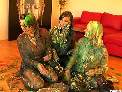 This kinky cat fight scene in fucked up for sure. Three smoking hot Euro chicks get wild with paints. Bitches struggle right on the floor all covered with brown and green paint.