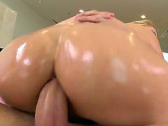 Arousing blonde milf Katja Kassin with big tits and heavy make up gets her huge round ass oiled and boned deep all over the living room by her horny lover.