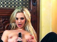 Pretty long haired young blonde Sophia Knight with natural medium boobs and slim sexy body in black stockings only teases and stuff honey pot  with vibrator on the floor.