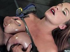 Well-endowed milf Bella Rossi lets horny stud Maestro put her into irons. Then Maestro pokes his big cock between Bella's tits and enjoys a terrific titjob.