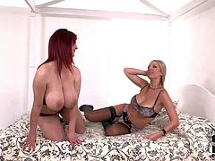 Blonde and black haired lesbian cougars Carol and Vanessa with gigantic tits and juicy asses get naked while making out and pleasure each other in arousing sensual fantasy