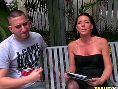 Salacious sunburned mom talks with horny guy sitting on the bench. She flashes her big ass in black undies while getting into car.