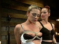 Bailey Blue the submissive slut gets tied up and covered with hot wax by redhead Maitresse Madeline. Then she gets fucked in her ass with a strap-on.