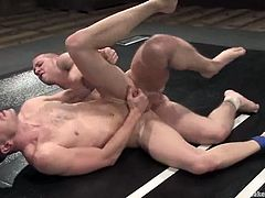Two dudes get on the pitch naked for a wrestling match. But the temptation for a nice gay sex was high and they started fucking!