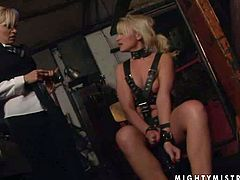 Eegant lesbian dominatrix Lee Lexxus has a great tiome playing with helpless blonde Cynthia Moore in the dark of the dungeon. She explores slave girls lovely body with enthusiasm.