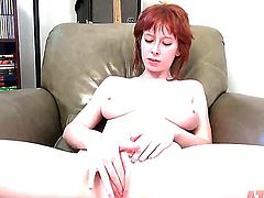 Busty redhead Zoey Nixon fingers cunny in armchair
